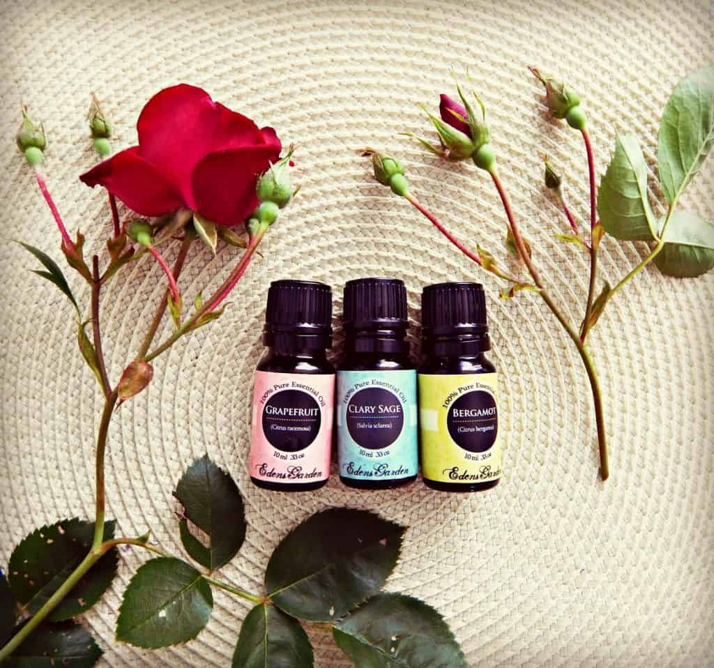 essential oil bottles on place mat surrounded by roses