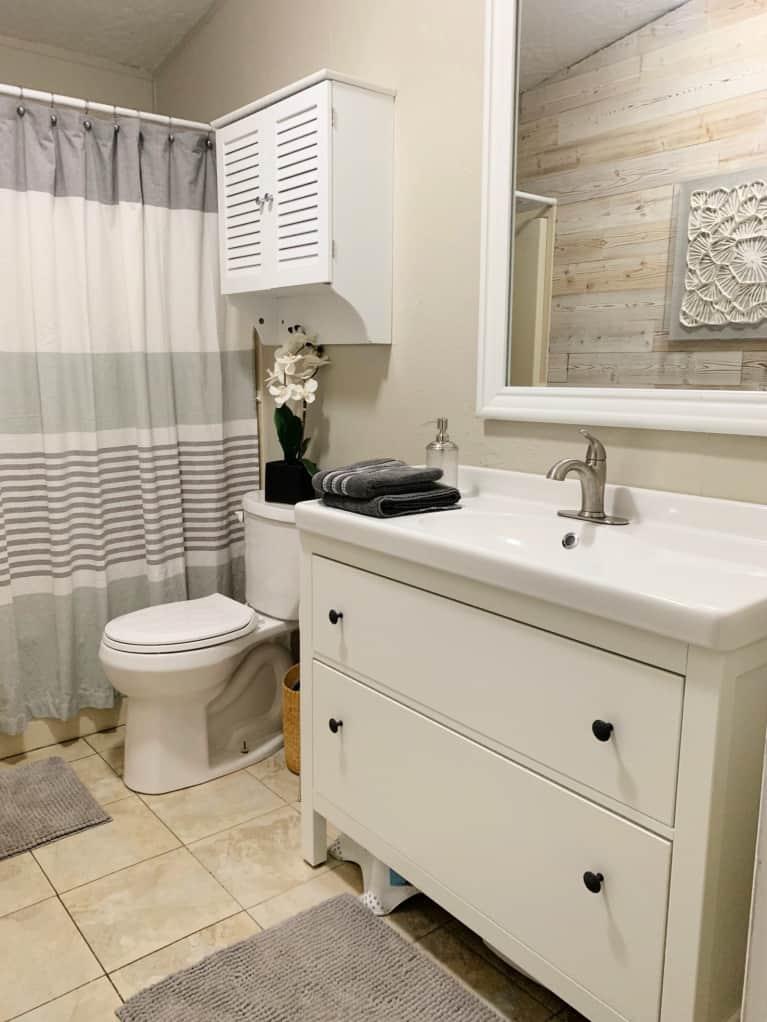 small bathroom in neutral tones