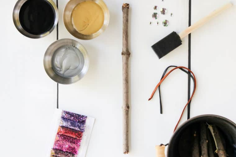 craft supplies for making a diy harry potter wand on white table