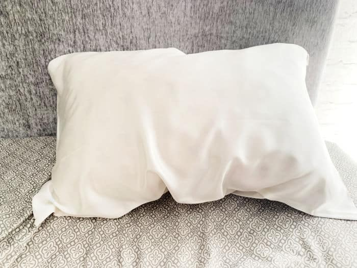silk pillowcase on grey bedding