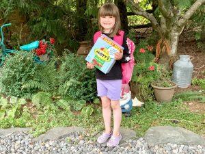 girl holding box of snacks