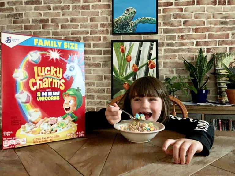 girl eating bowl of lucky charms