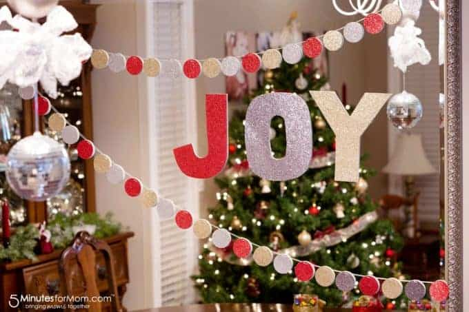 circle garland and joy cut out hanging in dining room