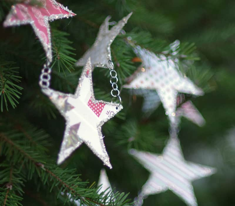 stars cut out of paper and hanging from chain