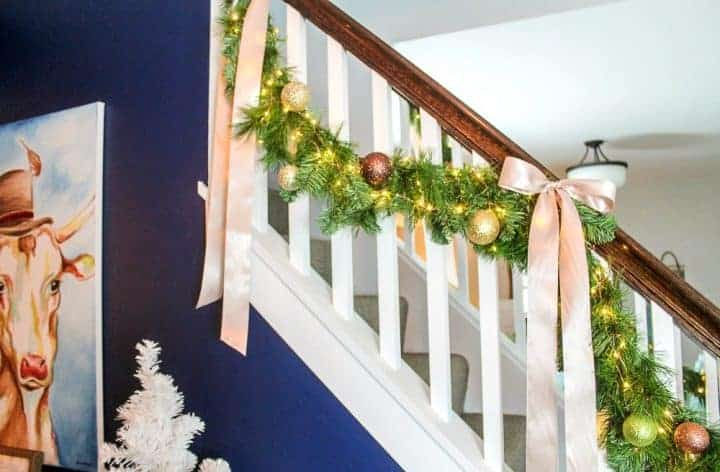 staircase with greenery garland hung from it