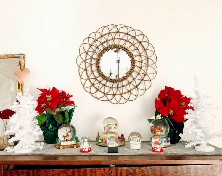 snow globes on a wooden dresser make lovely Christmas bedroom decor.