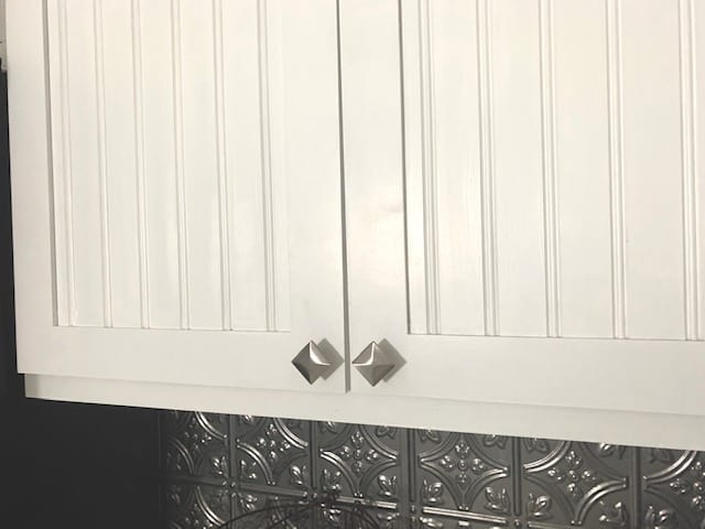 white beadboard kitchen cabinets
