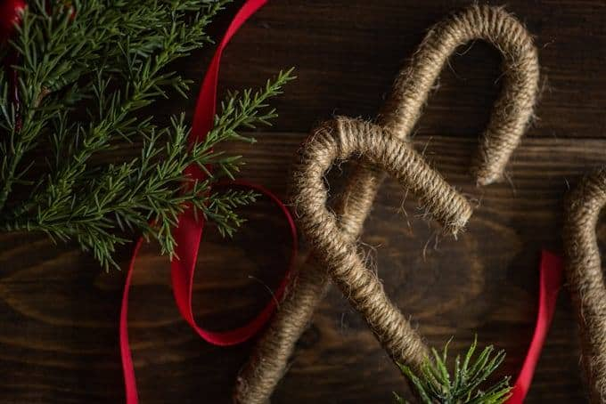 twine candy canes on a wood table